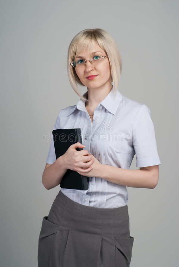 Young attractive businesswoman holding diary royalty free stock photography