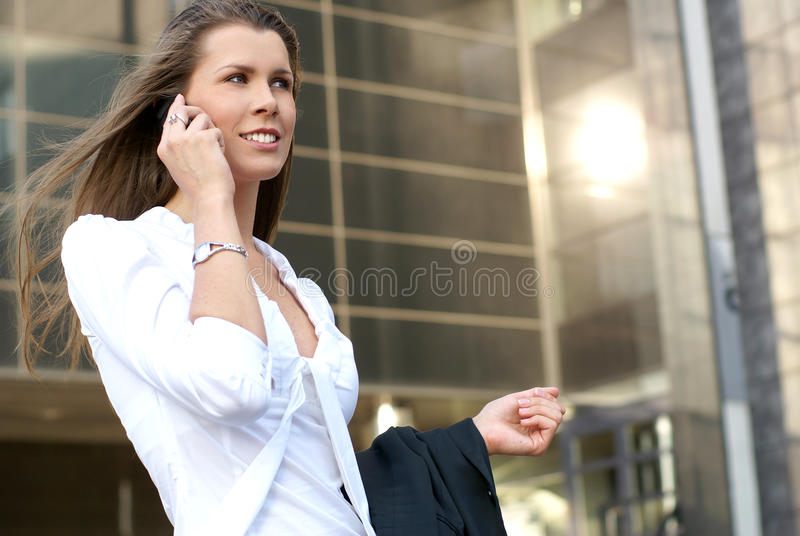 A Young And Attractive Businesswoman With A Phone Royalty Free Stock Photography