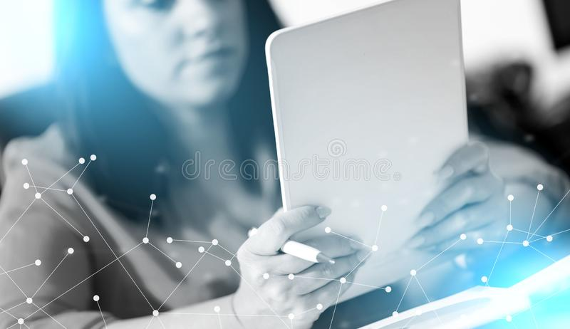 Young attractive businesswoman using a tablet; light effect. Young attractive businesswoman using a tablet at office; light effect stock photography