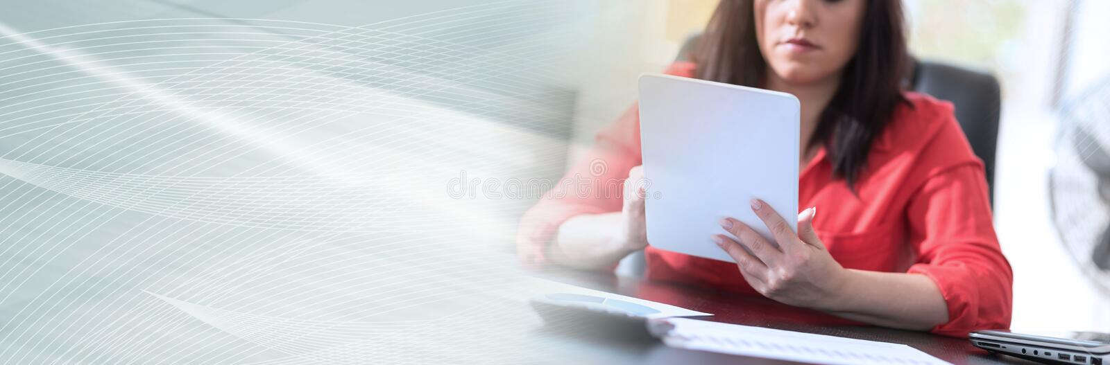 Young attractive businesswoman using a tablet, panoramic banner stock photo