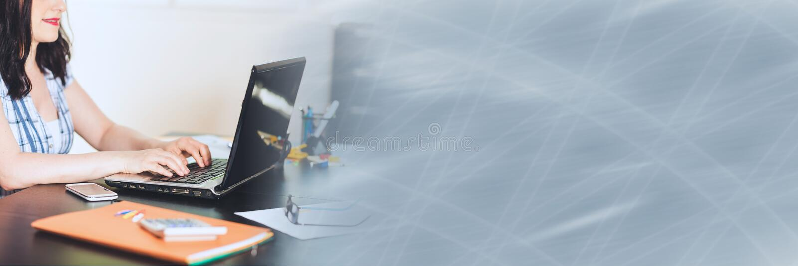 Young attractive businesswoman working on laptop, light effect; panoramic banner stock images