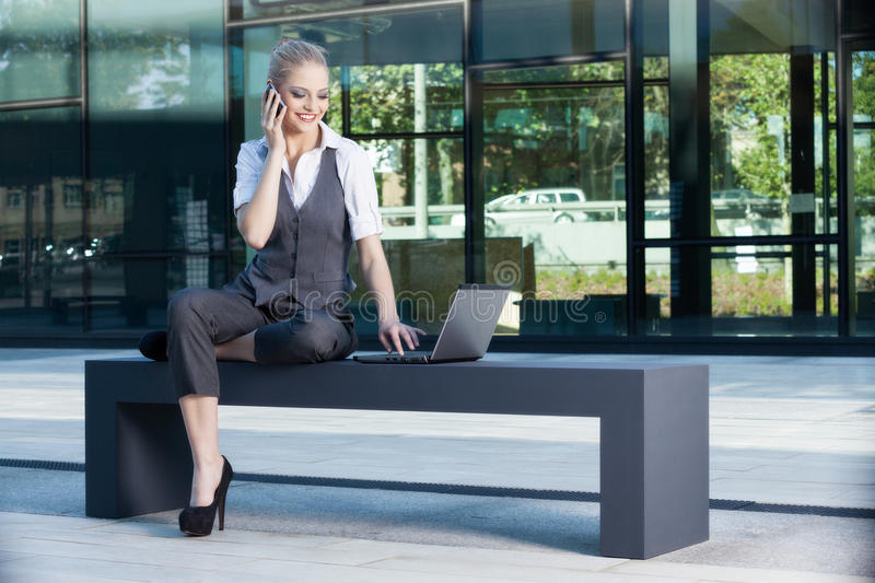 Young and attractive businesswoman working on laptop stock image