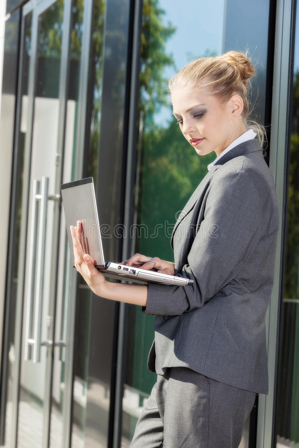 Young and attractive businesswoman working on laptop royalty free stock image