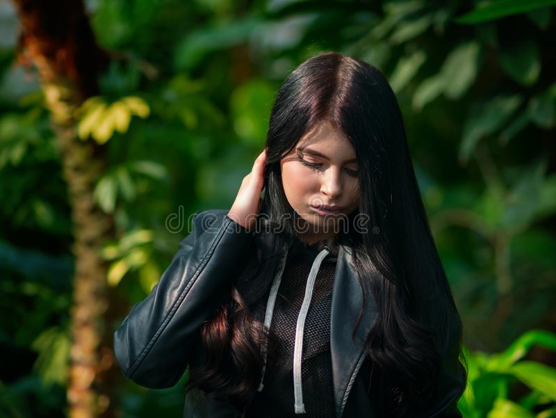 Young attractive caucasian girl or woman wearing leather jacket royalty free stock photos