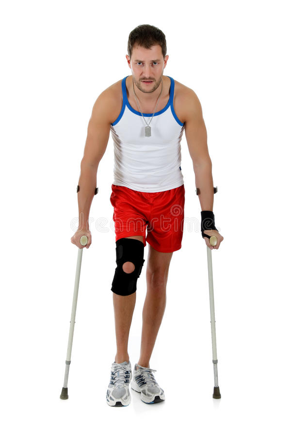 Young attractive caucasian man athlete, crutches royalty free stock photo