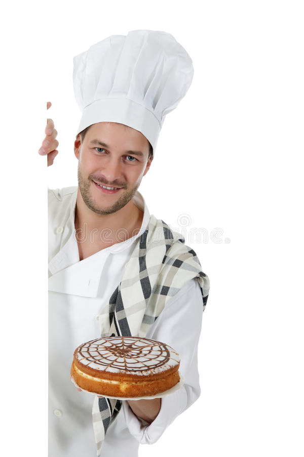 Young attractive caucasian man chef, cake royalty free stock photo