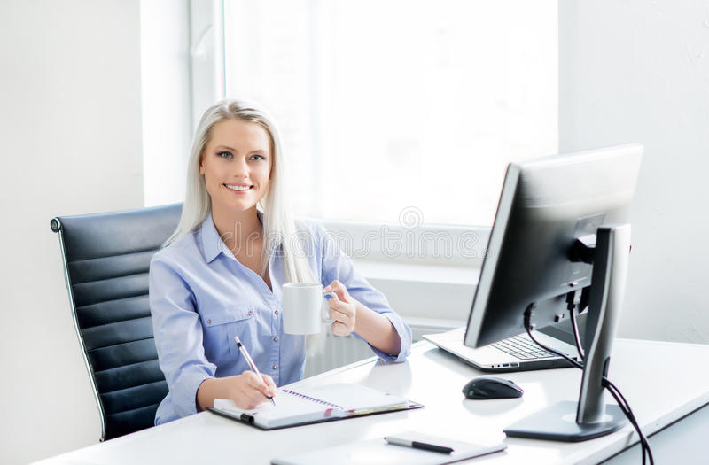 Young, attractive and confident businesswoman working in office.  royalty free stock images