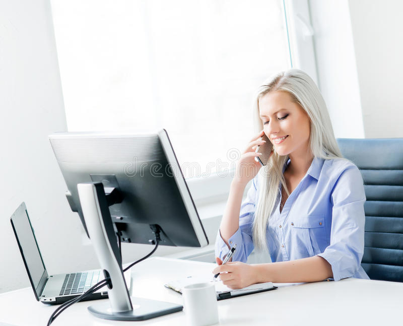 Young, attractive and confident businesswoman working in office.  royalty free stock photo