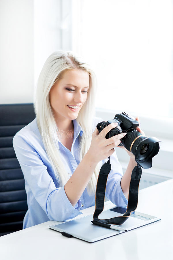 Young, attractive and confident woman working in office royalty free stock photos
