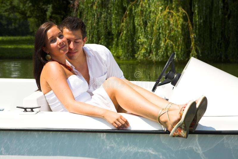 Young attractive couple on boat stock image