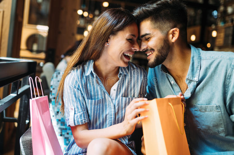 Similar images, stock photos vectors of portrait of positive adult couple choosing erotic toys in sex shop