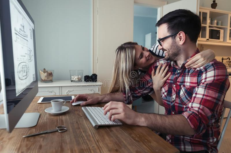 Young couple of designers working on computer stock images