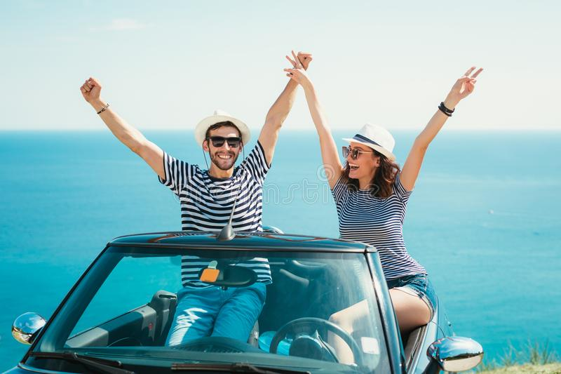 Young attractive couple posing in a convertible car stock image