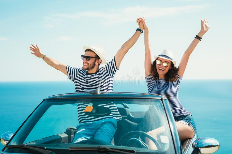 Young attractive couple posing in a convertible car stock photo