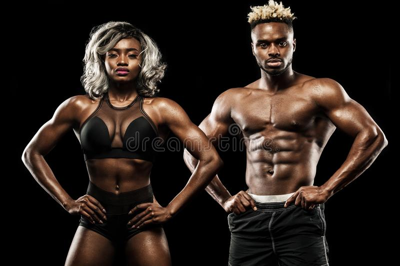 Fitness couple of athletes posing on black background, healthy lifestyle body care. Sport concept with copy space. royalty free stock photography