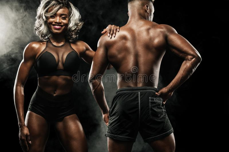 Fitness couple of athletes posing on black background, healthy lifestyle body care. Sport concept with copy space. stock images