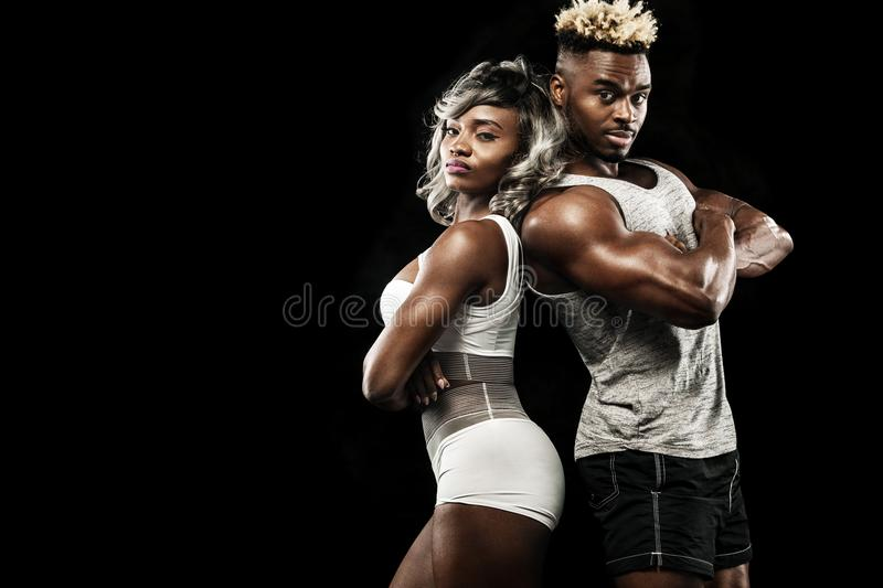Fitness couple of athletes posing on black background, healthy lifestyle body care. Sport concept with copy space. royalty free stock images