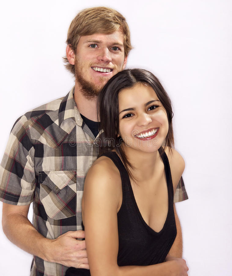 Young attractive couple smiling royalty free stock photo