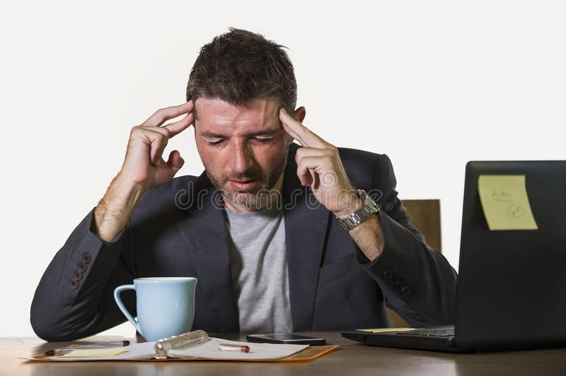 Young attractive depressed and frustrated businessman working at office computer desk desperate and overwhelmed feeling upset stock image