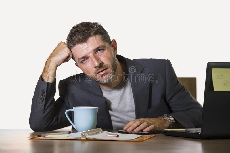 Frustrated man working at office computer desk desperate and overwhelmed feeling upset suffering depression and anxiety crisis in stock photos