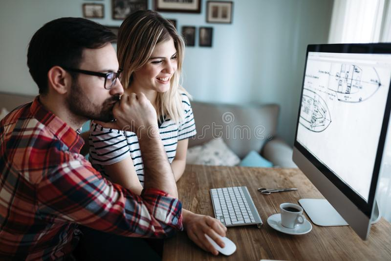 Young attractive designers working on project together royalty free stock images