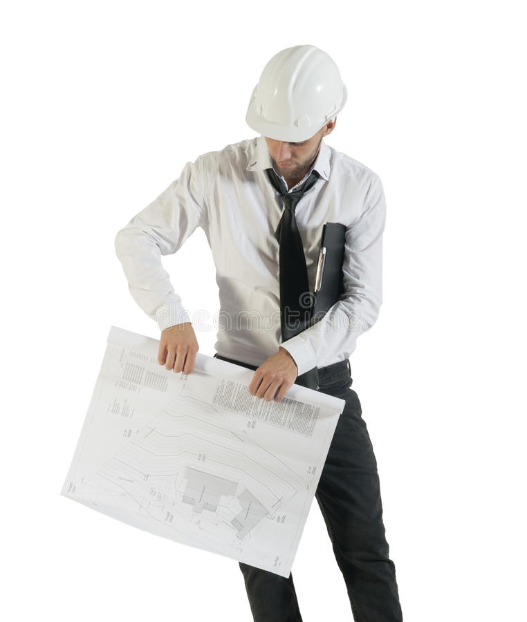 Young attractive engineer rolling up technical drawings. Isolated on white background royalty free stock photos