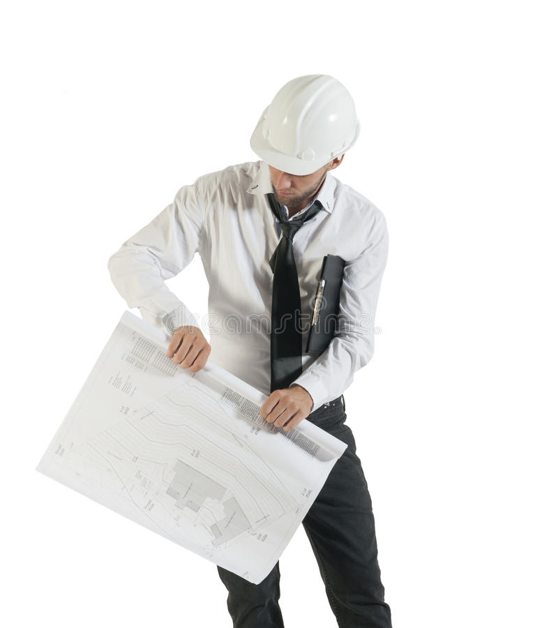 Young attractive engineer rolling up technical drawings. Isolated on white background stock photo