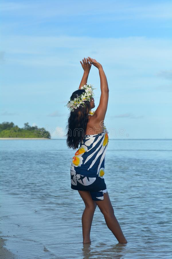 Young attractive exotic Polynesian Cook Islander woman dance in royalty free stock photo