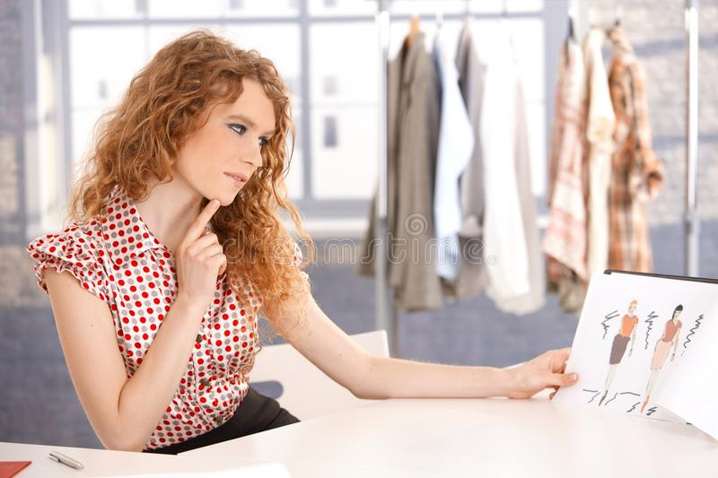 Young attractive fashion designer working royalty free stock images
