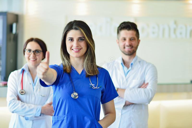 Young Attractive female doctor in front of medical group. stock photo