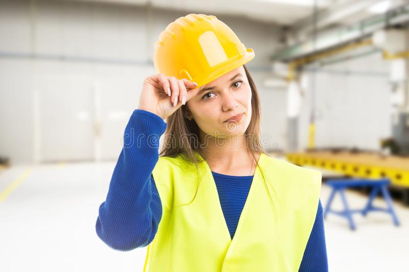 Young attractive female engineer greeting royalty free stock image