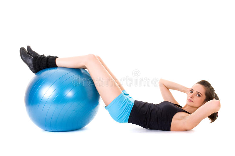 Young attractive female exercise using blue ball royalty free stock image