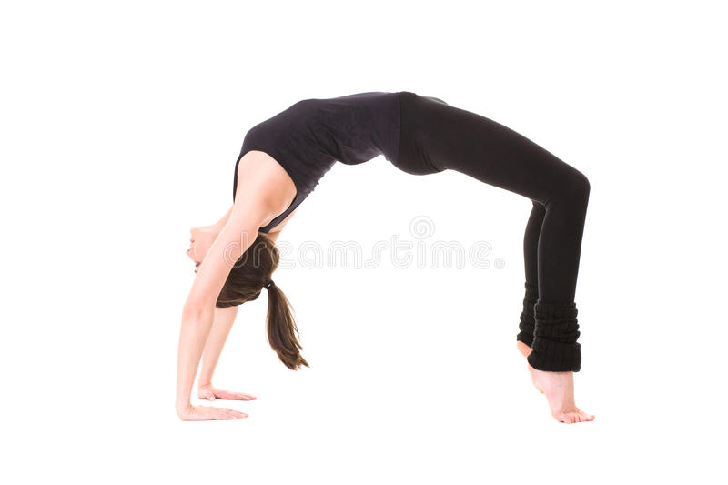 Young attractive female in stretch pose, isolated stock image