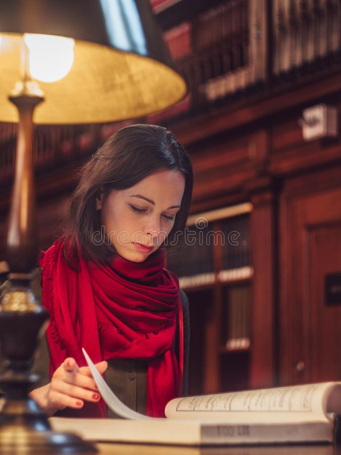Young attractive female student in the library. Of New York royalty free stock photo