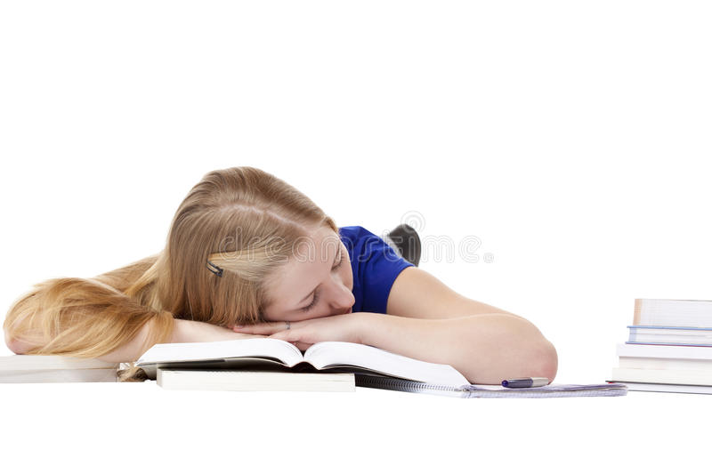 Young attractive female student sleeping at books. On floor. Isolated on white background royalty free stock photography
