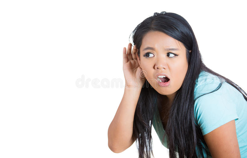 Young attractive female trying to secretly listen in on a conversation and shocked at what she hears, privacy violation,