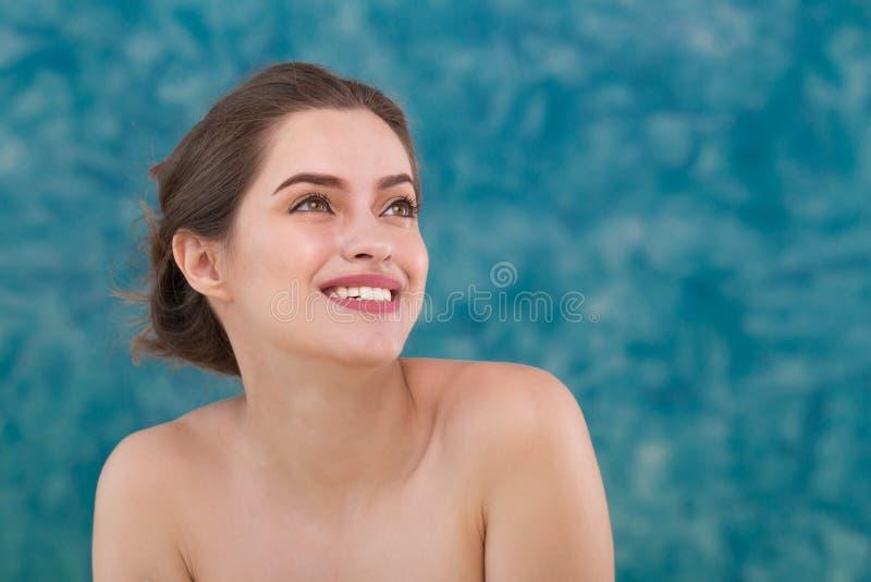 Naked girl holding face