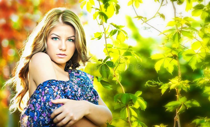 Download Young Attractive Girl With Blue Dress  Outdoor Stock Image - Image: 24828957