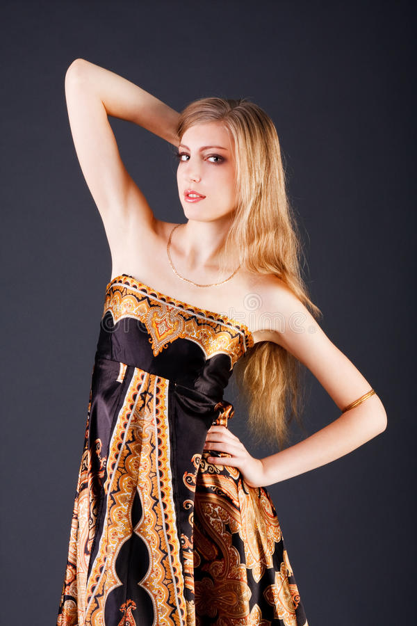 Young attractive girl in dress stock image