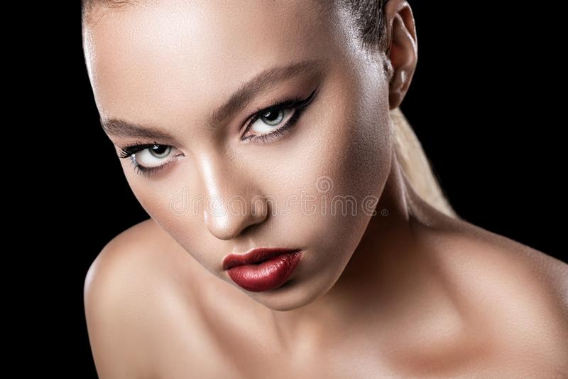 Young attractive girl model close up. Bright evening makeup. stock image