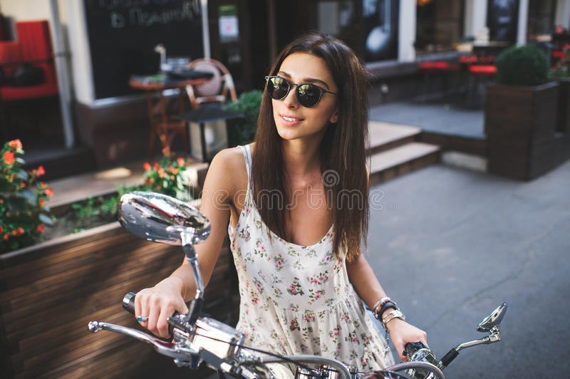 Young attractive girl and vintage old scooter royalty free stock photography