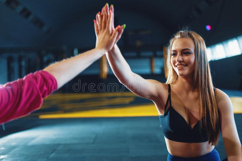 Young attractive girls giving five stock image