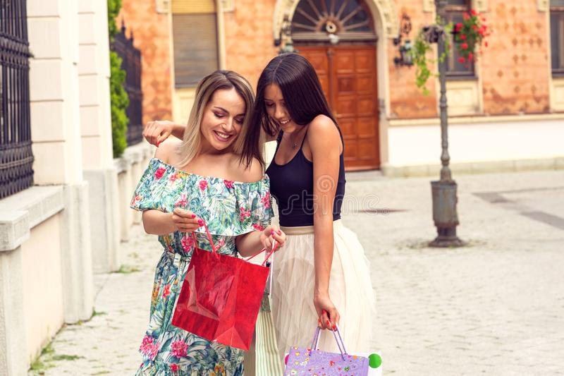 Young girls with shopping bags in the city royalty free stock photography