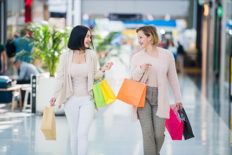 Young attractive girls with shopping bags at mall.  stock photography