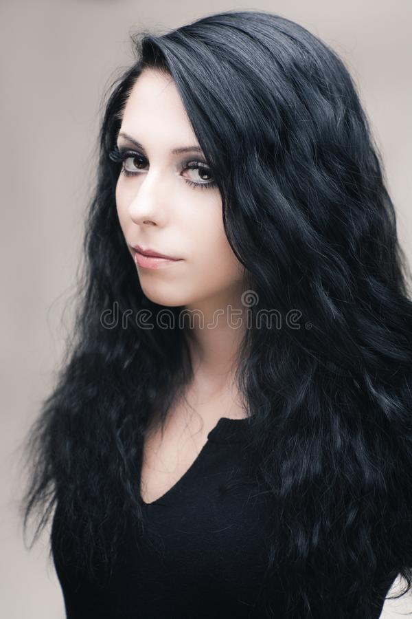 Young attractive gothic brunette woman. Over gray royalty free stock photos