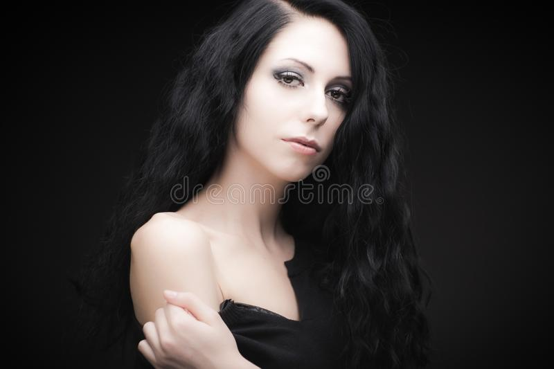 Young attractive gothic brunette woman. Over black royalty free stock photography