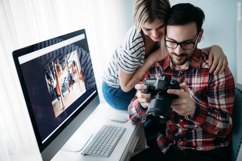 Young attractive designers working on project together royalty free stock image