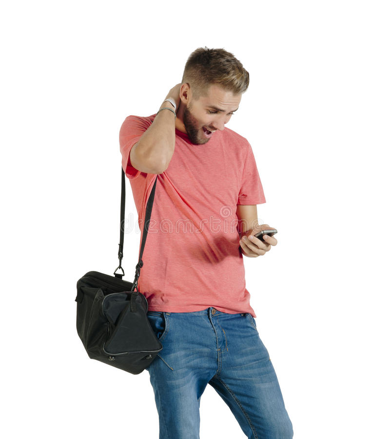 Young Attractive Guy Acting Surprised While Using His Mobile Phone Stock Photo