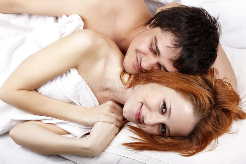 Young attractive happy amorous couple at bedroom stock photo
