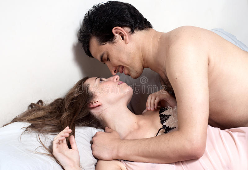 Download Young Attractive Happy Couple In Bedroom Stock Photos - Image: 18298493